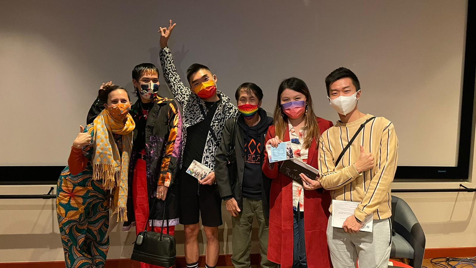 There are 6 people dressed up in colorful clothes, wearing masks due to COVID-19. This picture shows a few CHAT team members as well as participants from the Introductory Session.